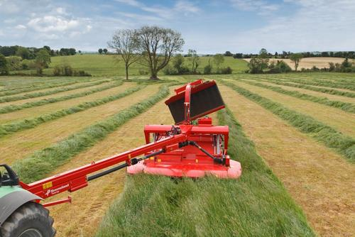 When not in use the swath belt is raised hydraulically